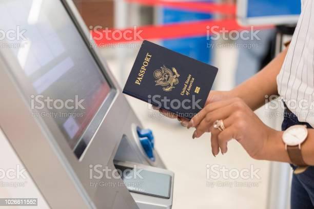 Woman uses automated passport control kiosk picture id1026611552?b=1&k=6&m=1026611552&s=612x612&h=s2u s3snzookkdvfadu umu5ln92gwhs5egi63zx8dm=