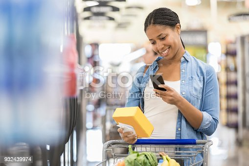 istock Woman uses grocery store mobile app while shopping 932439974