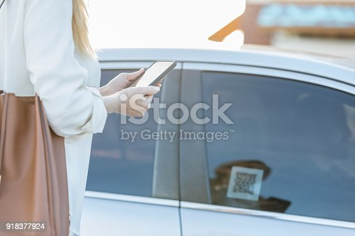 918377954 istock photo Woman uses ride share app after a day of shopping 918377924