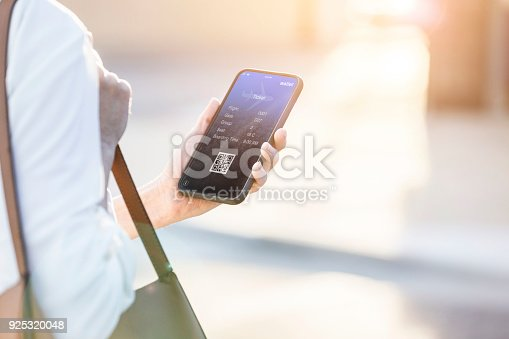 istock Woman uses smart phone to book travel reservation 925320048