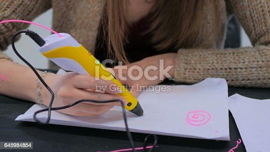 istock Woman using 3D printing pen 645984854