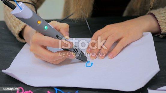 istock Woman using 3D printing pen 645985080