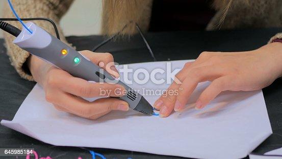 istock Woman using 3D printing pen 645985184