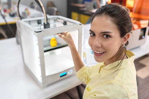 istock Woman using a 3D printer 1021336864