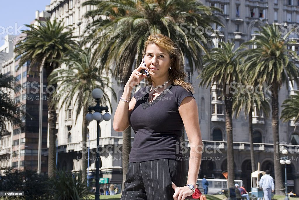Woman Using a Cell Phone royalty-free stock photo
