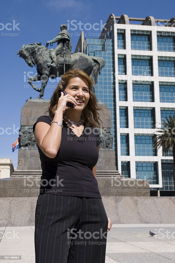Woman Using a Cell Phone stock photo