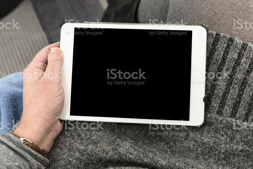 woman using a digital tablet on the sofà royalty-free stock photo