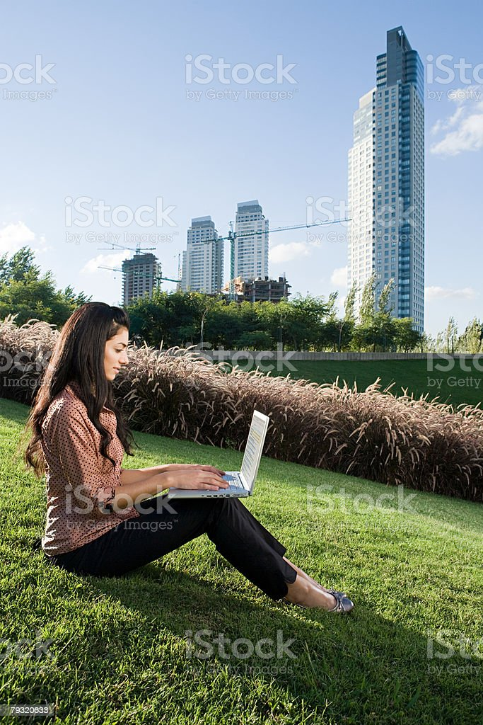 Woman using a laptop computer on hill royalty-free stock photo