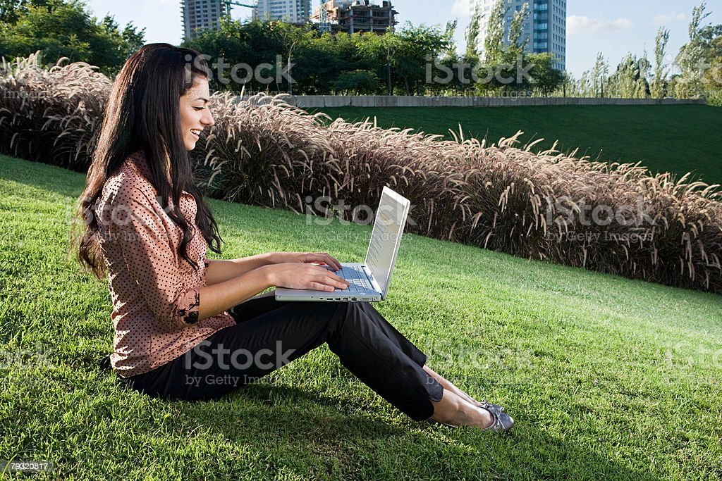 Woman using a laptop computer on hill royalty-free 스톡 사진