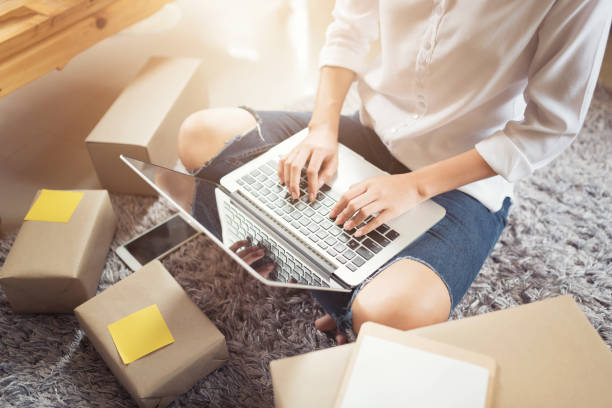 Woman using a laptop for online shopping stock photo