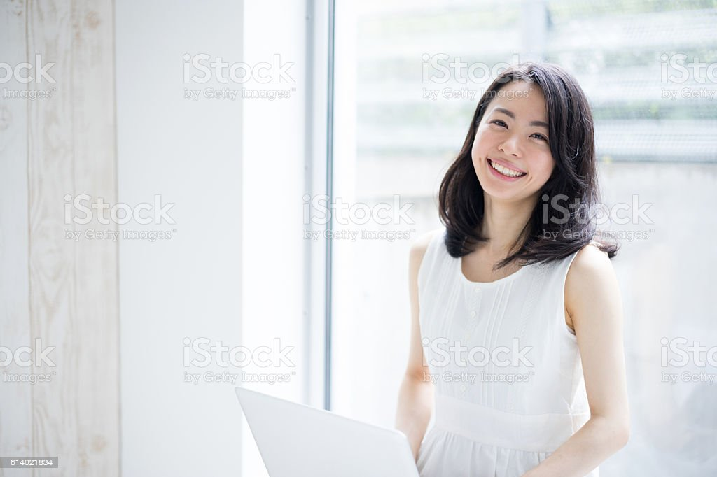 Woman using a laptop bildbanksfoto