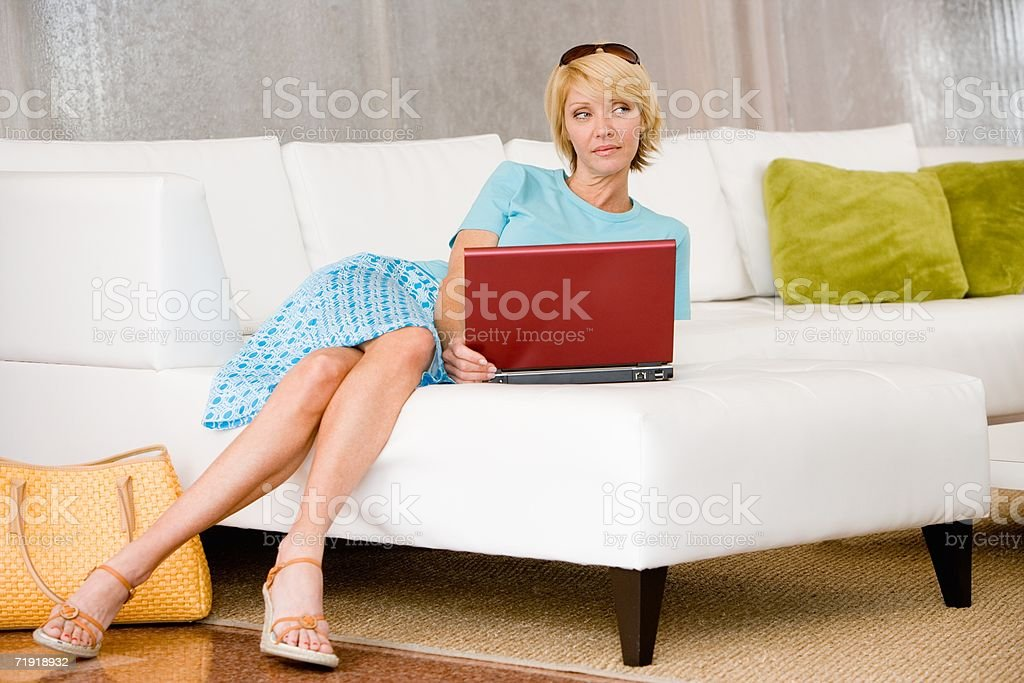 A woman using a laptop royalty-free stock photo