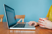 istock Woman Using a Laptop While Drinking Coffee 1224817285