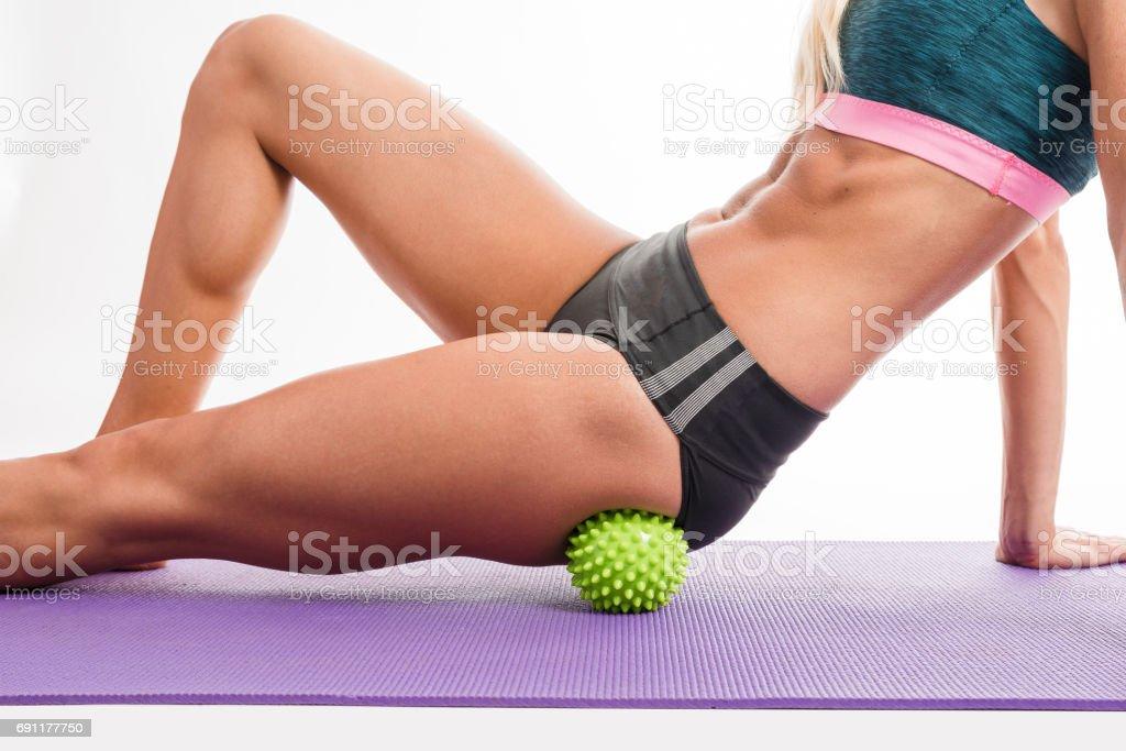 A woman using a massage ball – zdjęcie