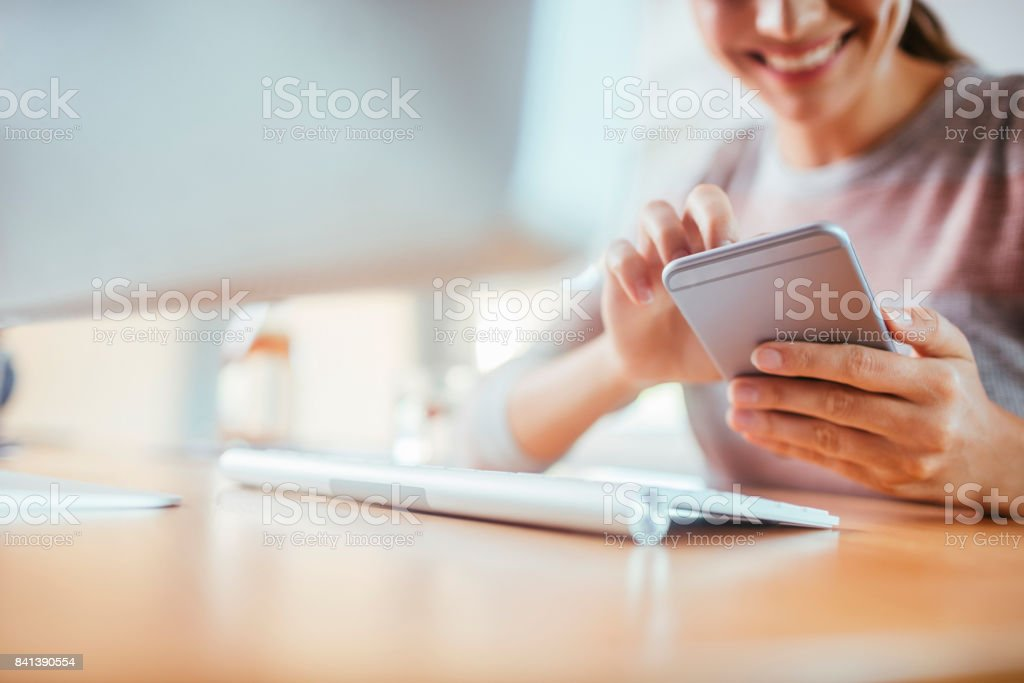 Woman using a phone stock photo