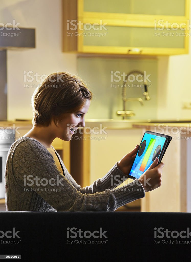 Woman using a Smart Energy Controller royalty-free stock photo