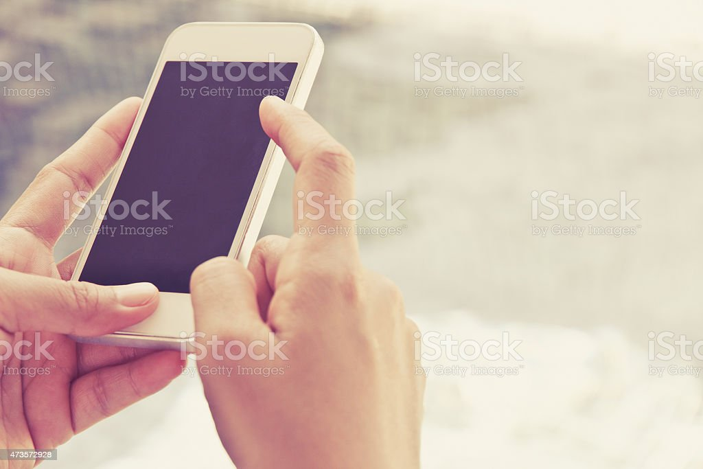 Woman Using a Smart Phone royalty-free stock photo