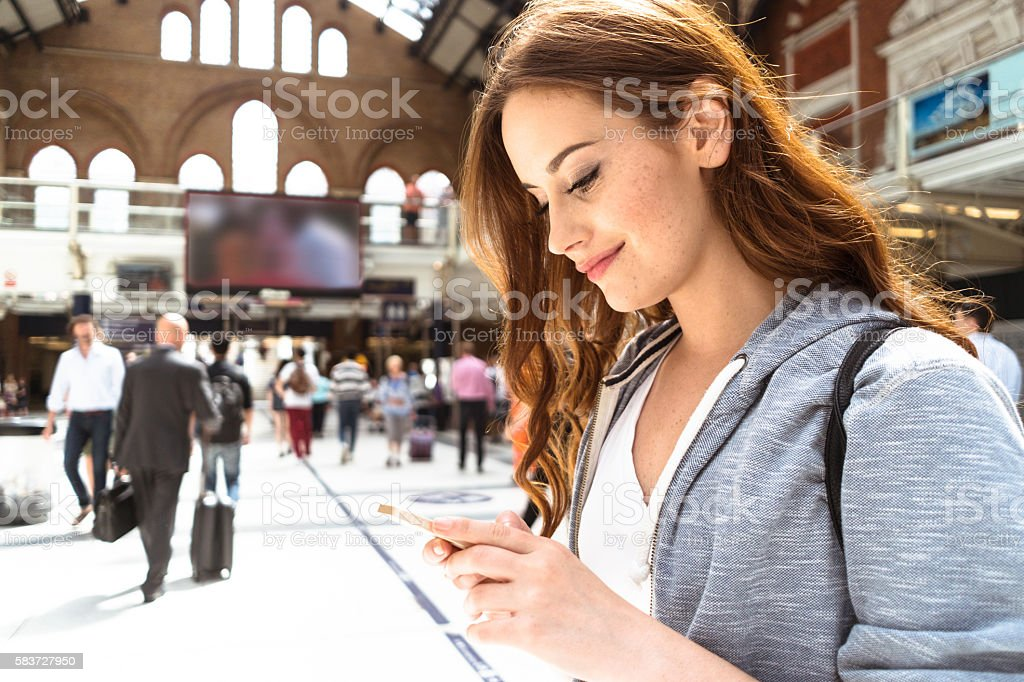 woman using a smartphone on liverpool street stock photo
