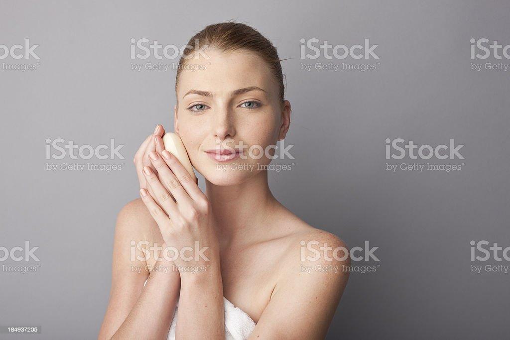 woman using a soap bar royalty-free stock photo