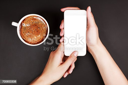 istock Woman using a touch screen of smart phone 700653308