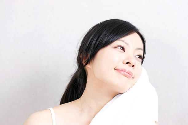 Woman using a towel ストックフォト