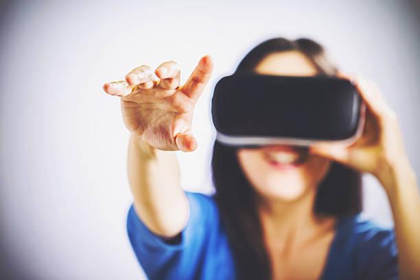 bf5da02cabc2 Woman using a virtual reality headset stock photo
