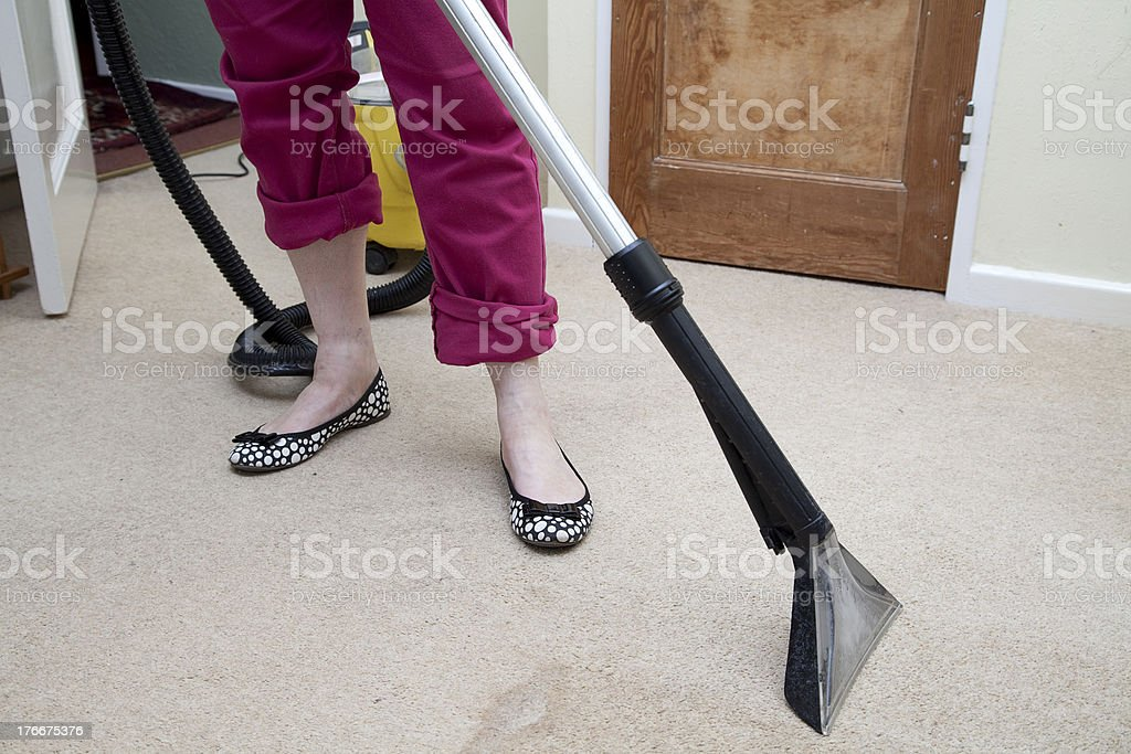 Woman using a Wet Carpet Washer royalty-free stock photo