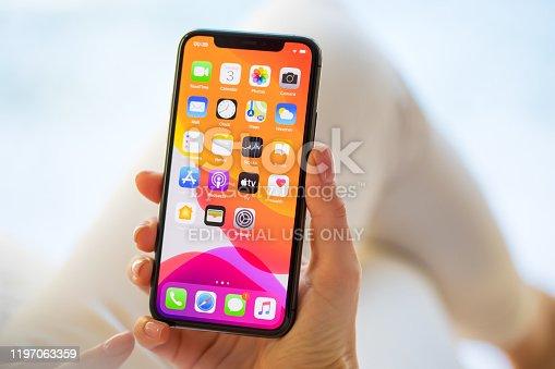 Riga, Latvia - December 3, 2019: Woman using Apple iPhone 11 Pro.