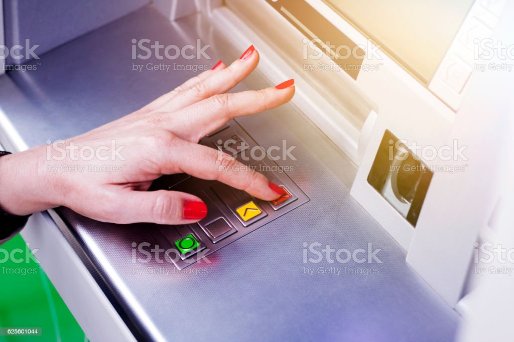 Woman using ATM stock photo