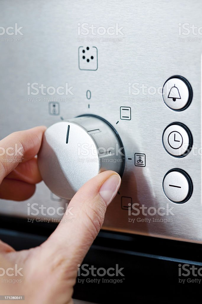 Woman using baking-oven royalty-free stock photo