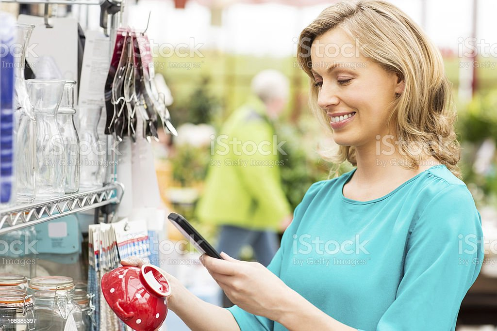 Woman Using Barcode Reader Through Cell Phone royalty-free stock photo