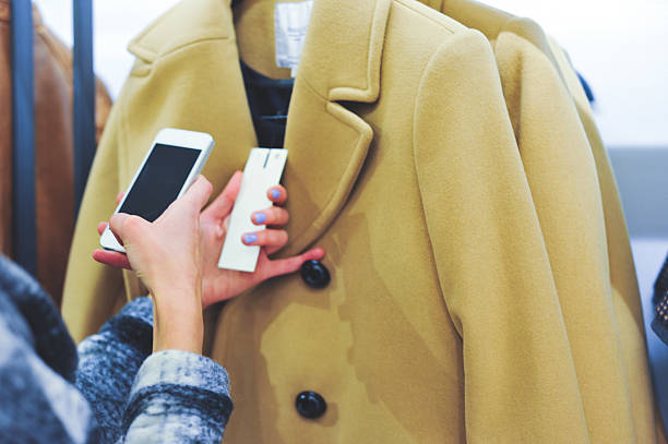 Woman Using Barcode Reader Through Smart Phone stock photo
