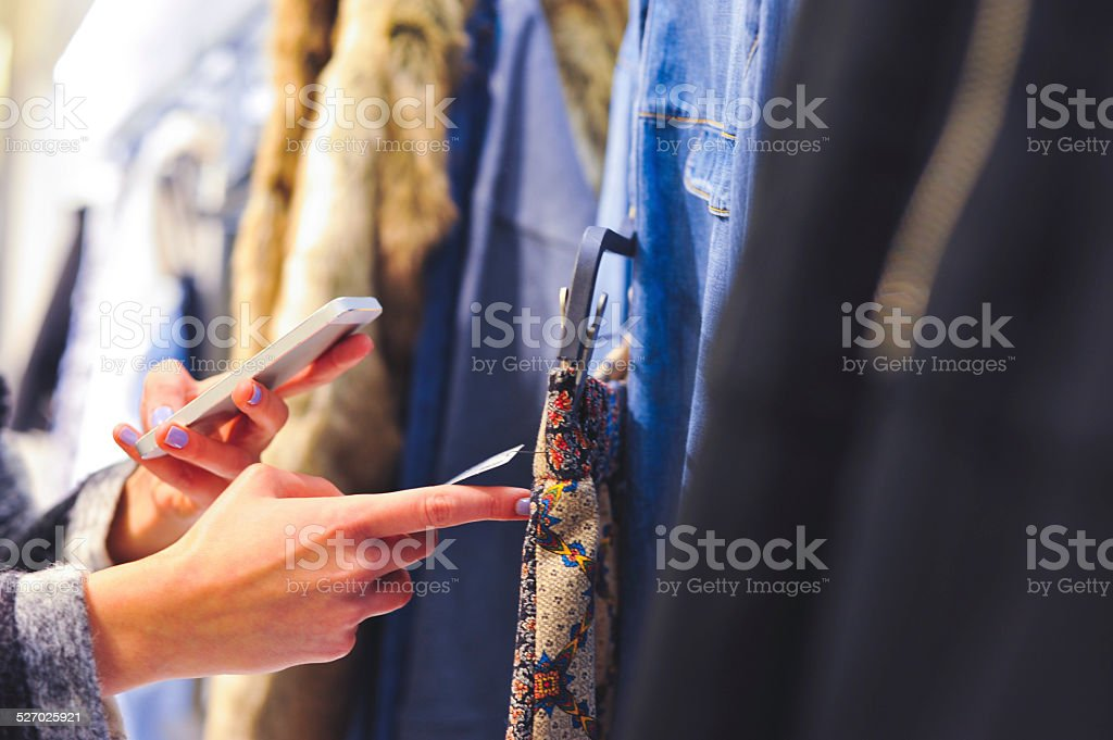 Woman Using Barcode Reader Through Smart Phone stock photo