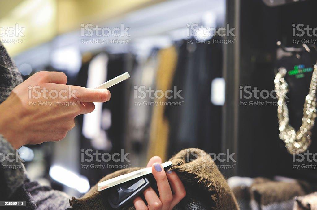 Woman Using Barcode Reader Through Smart Phone royalty-free stock photo