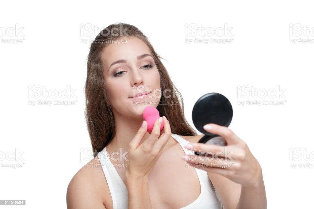 woman using beauty blender stock photo