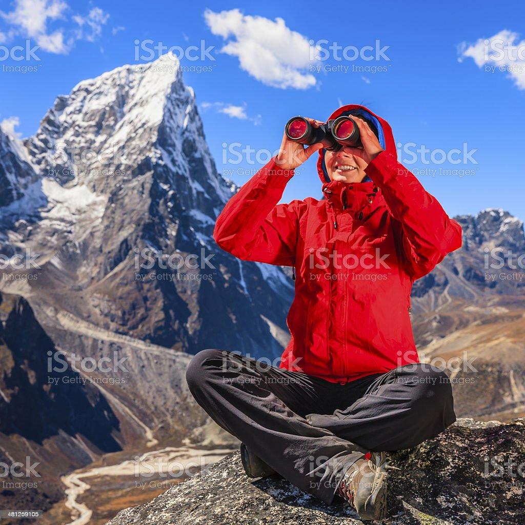 Woman using binoculars in Mount Everest National Park, Nepal royalty-free stock photo
