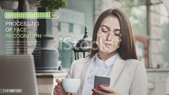 851960142istockphoto Woman using biometric facial verification on smartphone 1141687202