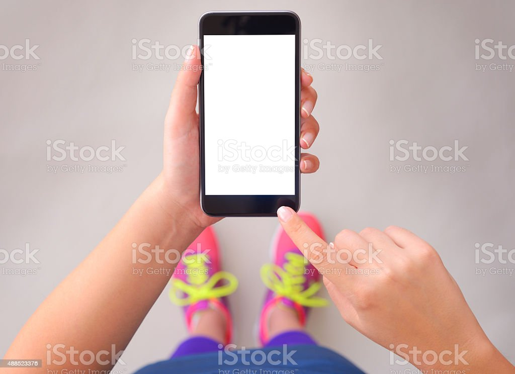Woman using blank white screen smart phone stock photo