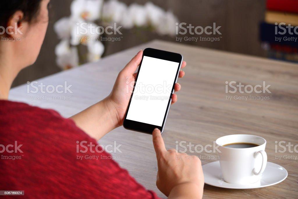 Woman using blank white screen smart phone stock photo