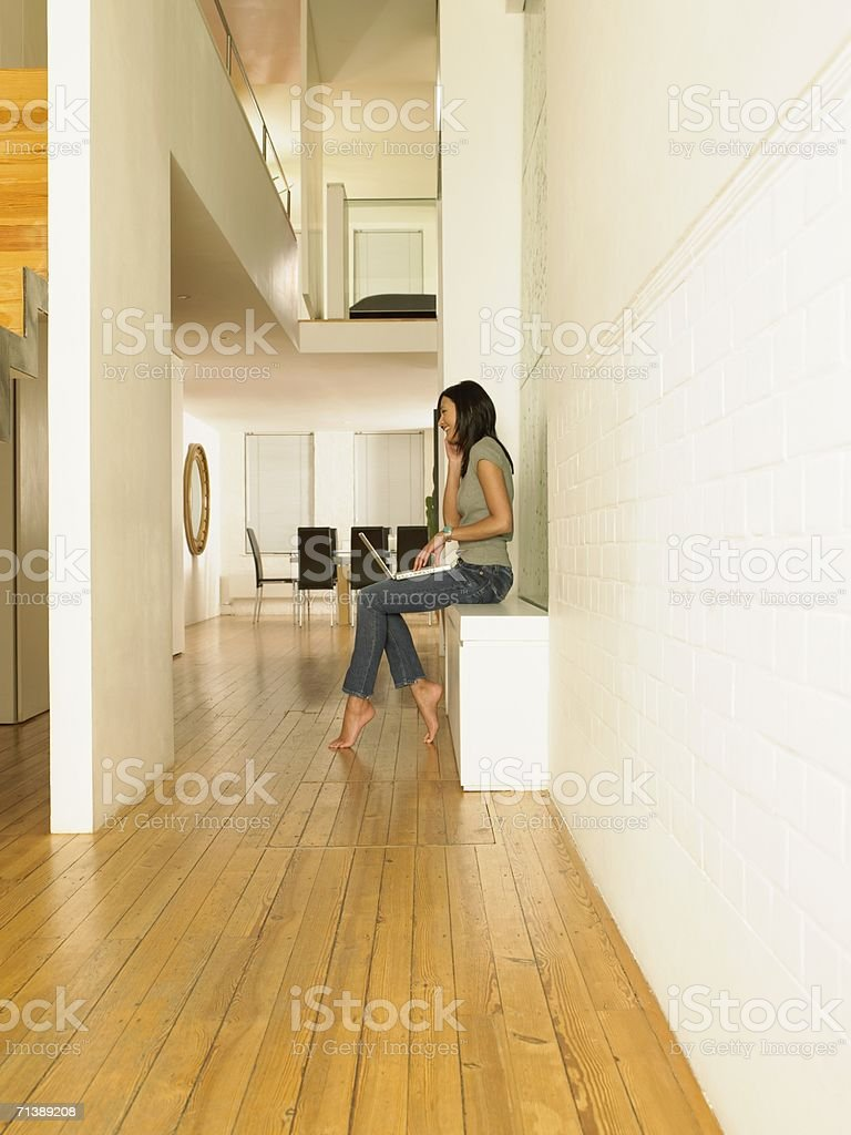 Woman using cell phone and laptop royalty-free stock photo