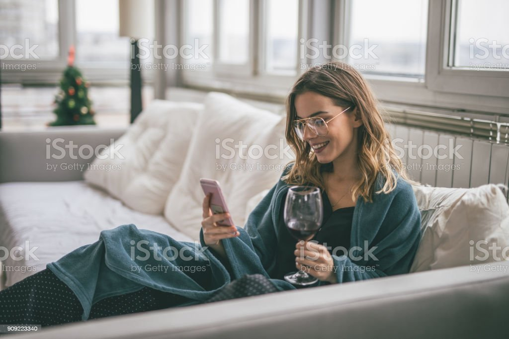 Woman using cell phone stock photo