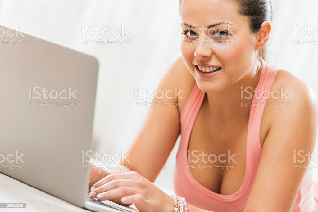 Woman using computer and looking at the camera. royalty-free stock photo