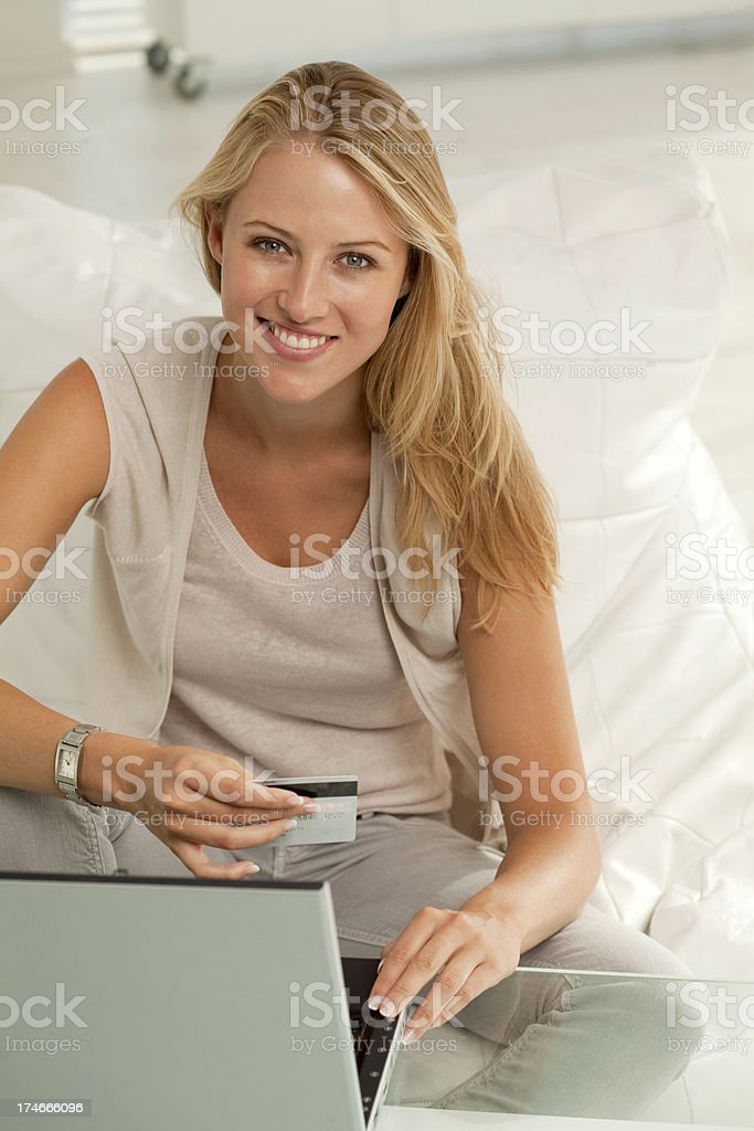 Woman using credit card and computer. royalty-free stock photo