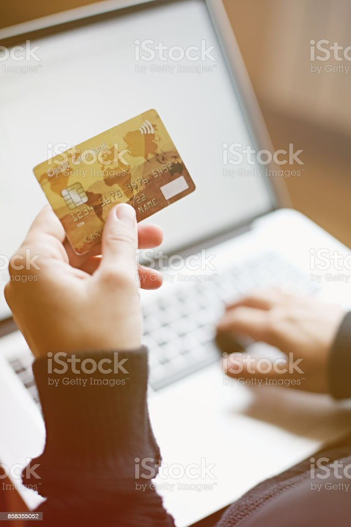 Woman using credit card for online purchase stock photo