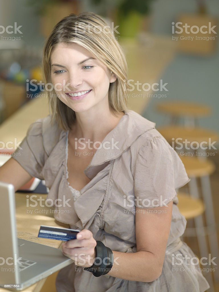 Woman using credit card to purchase online royalty-free stock photo