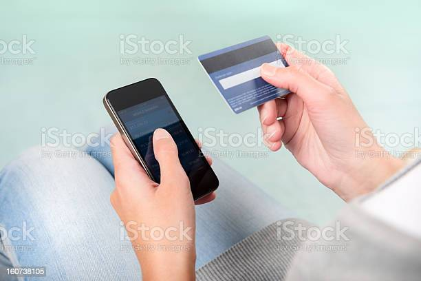 Woman Using Credit Card To Shop On Smart Phone Stock Photo - Download Image Now
