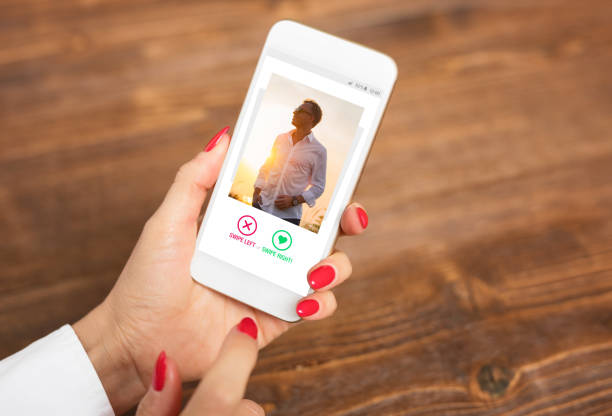 woman using dating app and swiping user photos - applications stock photos and pictures