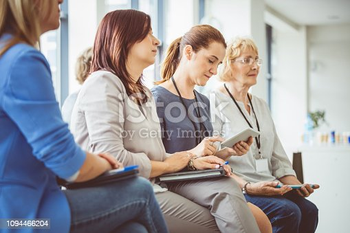 614852062 istock photo Woman using digital tablet during seminar 1094466204