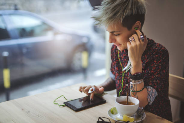Woman using digital tablet in a cafe stock photo