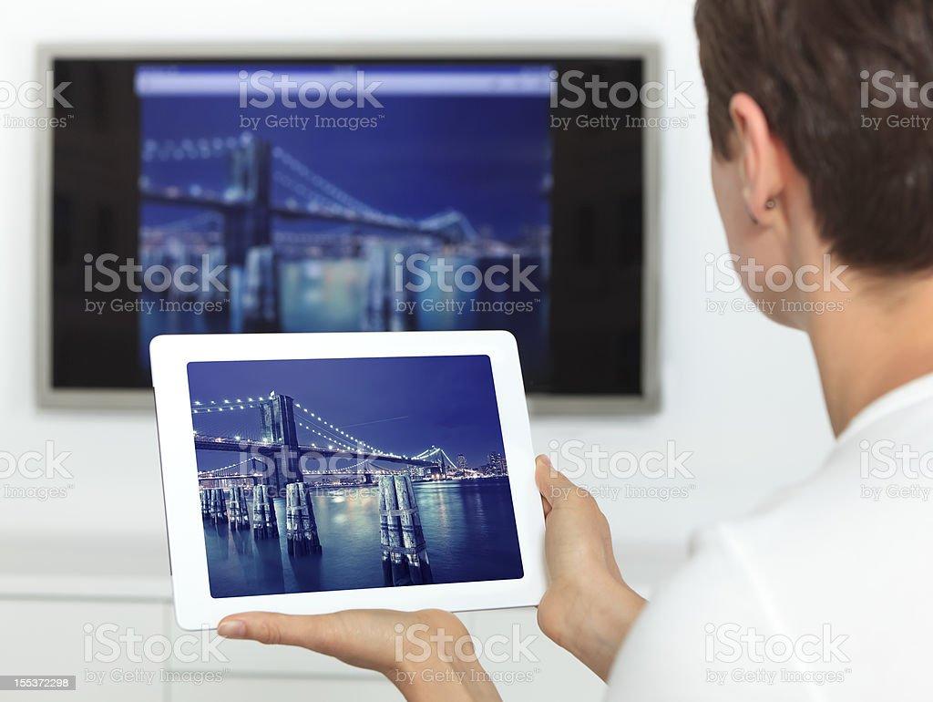 Woman using digital tablet royalty-free stock photo